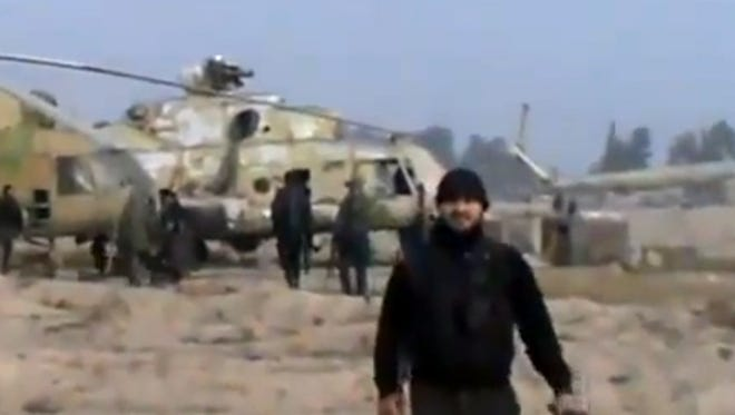 Syrian rebels capture a helicopter air base near the capital Damascus after fierce fighting in Syria on Sunday.
