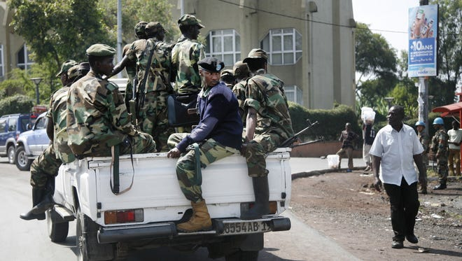 M23 rebels patrol around Congo's Central Bank in Goma, eastern Congo, on Monday.