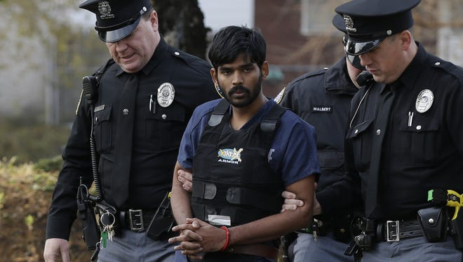 Raghunandan Yandamuri is escorted to a Montgomery County, Pa., district court for a preliminary hearing on Wednesday in Bridgeport, Pa. Investigators said Yandamuri killed 10-month-old Saanvi Venna and her grandmother, Satyavathi Venna, in a botched ransom kidnapping. He is being held without bail on murder, kidnapping and other charges.