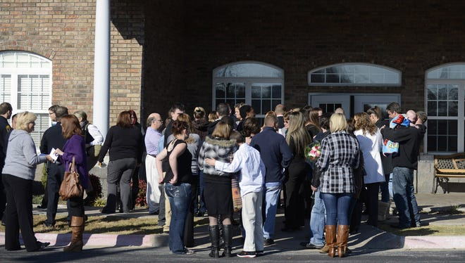 Mourners gather outside the chapel at Rollins Funeral Home in Rogers, Ark., Nov. 27, following a funeral service for 6-year-old Jersey Bridgeman.