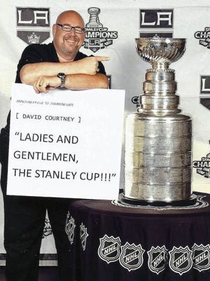 David Courtney showcases the Kings' 2012 Stanley Cup in an undated photo.