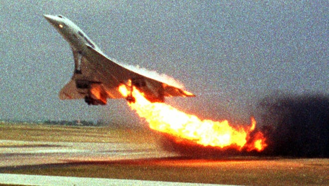 In this July 25, 2000,  Air France Concorde Flight 4590 takes off from Charles de Gaulle airport in Paris with fire trailing from its engine.