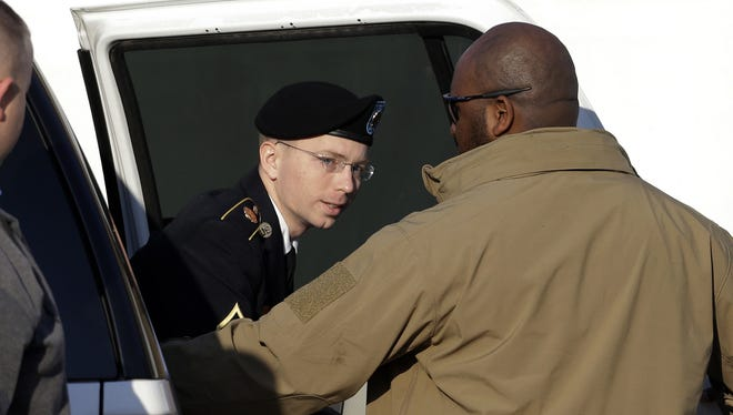 Army Pfc. Bradley Manning steps out of a security vehicle as he is escorted into a courthouse in Fort Meade, Md. on Thursday.