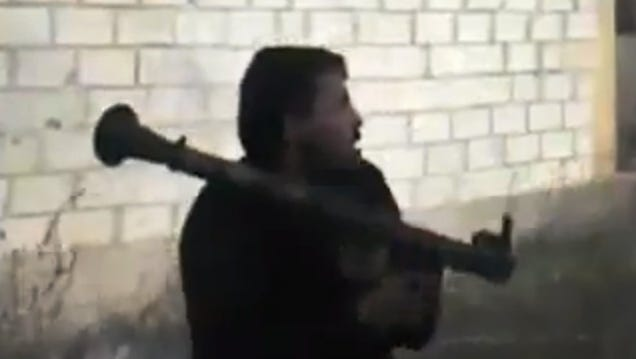 A Free Syrian Army fighter holds a weapon in Daraa.