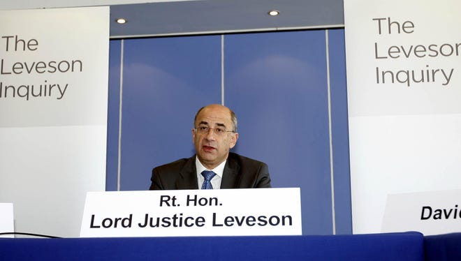 Lord Justice Brian Leveson speaks during the first formal session of his phone hacking inquiry in London last year.