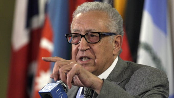Lakhdar Brahimi, Joint Special Representative of the United Nations and the League of Arab States for Syria, answers media questions after consultations at the U.N. headquarters on Thursday.