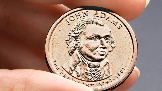 This undated file photo provided by the U.S. Mint shows the President John Adams presidential $1 coin.