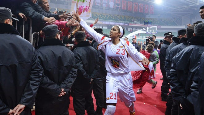 Maya Moore, seen here Nov. 24, greets fans before a game.
