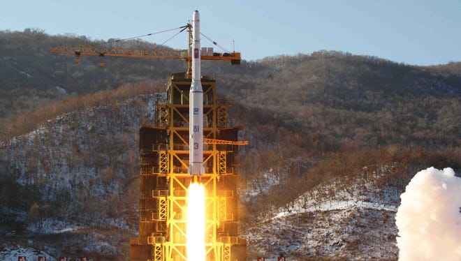 In this photo released by Korean Central News Agency, North Korea's Unha-3 rocket lifts off from the Sohae launch pad in Tongchang-ri, North Korea.