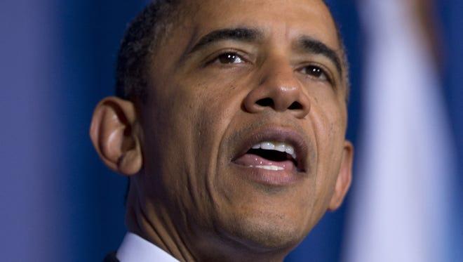 President Obama speaking at the Interior Department in Washington.