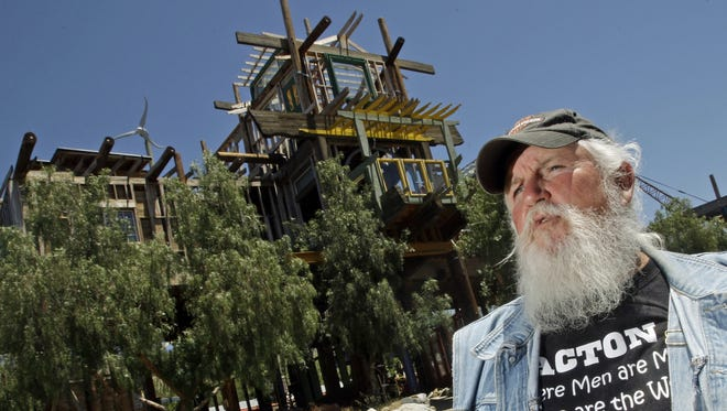 Kim Fahey is seen with his Phonehenge monument at his home in Acton, Calif.