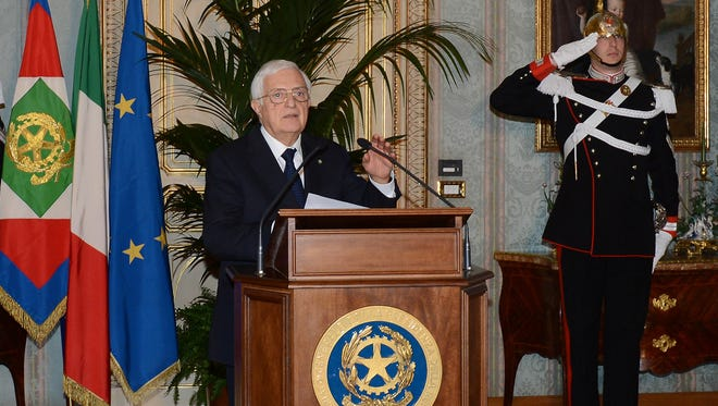 General Secretary Donato Marra officially announces the resignation of Mario Monti at the Quirinale presidential palace in Rome Friday.