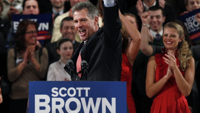 Sen. Scott Brown, R-Mass., pumps his fist during his re-election campaign kick-off in Worcester, Mass., on Jan. 19.