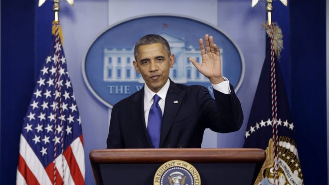 President Obama waves as he leaves the podium after speaking about the fiscal cliff in the Brady Press Briefing Room at the White House on Friday.