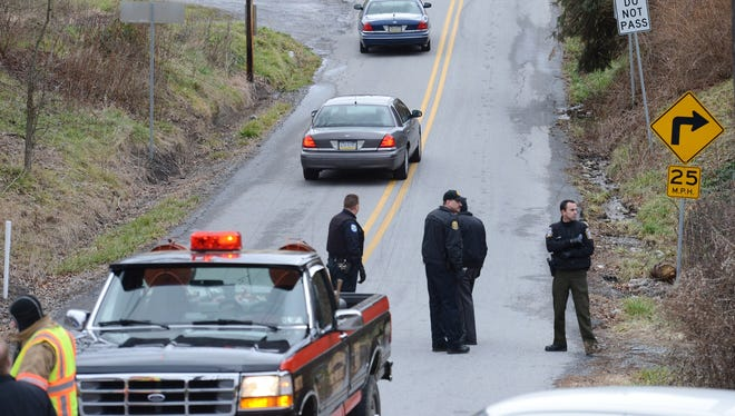 Local law enforcement block off Rt. 22 near the Canoe Creek State Park in Pennsylvania while investigating a shooting on Friday.