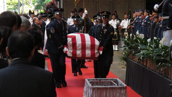 Pallbearers carry the casket of U.S. Sen. Daniel Inouye into the courtyard of the Hawaii state Capitol during a visitation ceremony in Honolulu on Saturday.