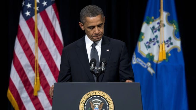 This Dec. 16 photo shows President Obama pausing during a speech at an interfaith vigil for the victims of the Sandy Hook Elementary School shooting in Newtown, Conn.