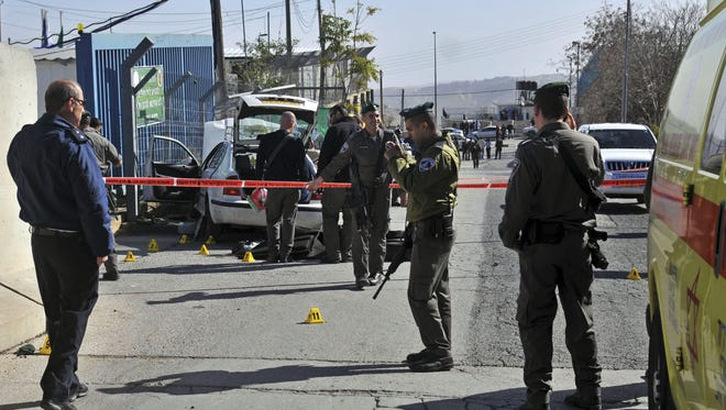 Israeli police cordon off the area next to the site of an attempted attack outside a police station in Jabel Mukaber in east Jerusalem on Sunday.