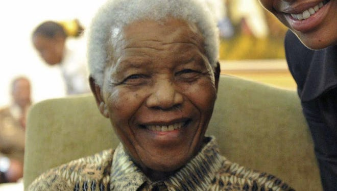 This May 16, 2011, file photo supplied by the South African Government Communications and Information Services, GCIS, shows former South African President Nelson Mandela and his wife Graca Machel.