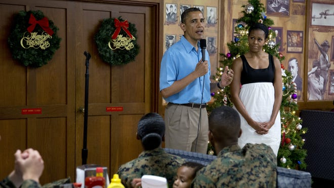 President Obama speaks as first lady Michelle Obama listens during a visit with members of the military and their families in Kaneohe Bay, Hawaii, on Tuesday.