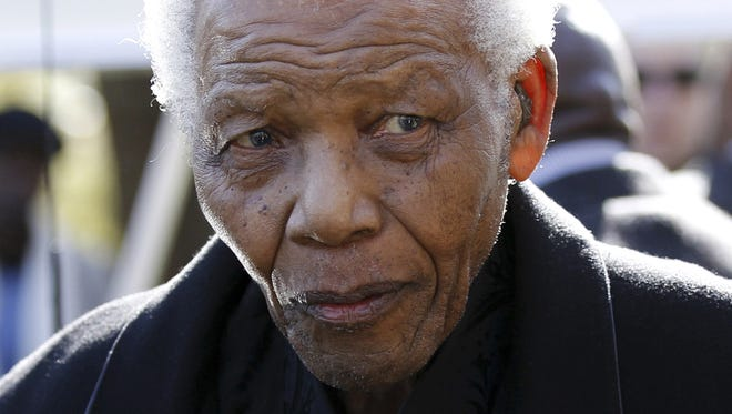 In this June 17, 2010 file photo, former South African President, Nelson Mandela  leaves the chapel after attending the funeral of his great-granddaughter Zenani Mandela in Johannesburg, South Africa.