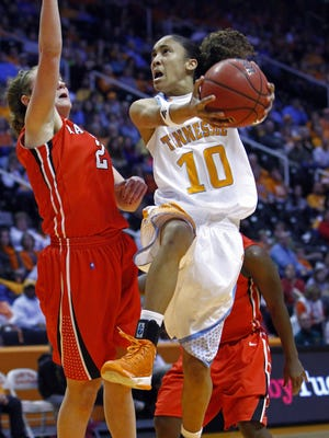 Tennessee guard Meighan Simmons drives past Davidson guard Laura Murray during Friday's 75-40 win.