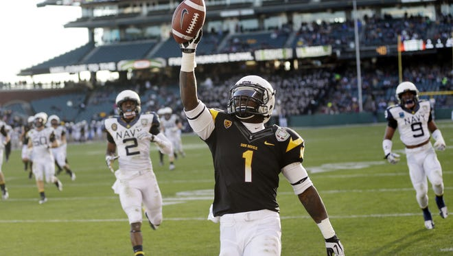 Arizona State running back Marion Grice celebrates his 39-yard touchdown run against Navy during the second half of the Kraft Fight Hunger Bowl in San Francisco.
