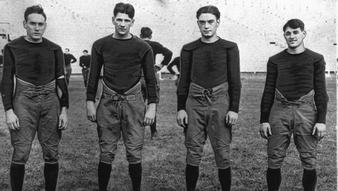 """In this 1924 file photo, Notre Dame's infamous backfield, """"The Four Horsemen,"""" from left, Don Miller, Elmer Layden, Jim Crowley and Harry Stuhldreherare pose on the practice field in South Bend, Ind. Notre Dame, led by the famed Four Horsemen, finished 10-0 in 1925."""