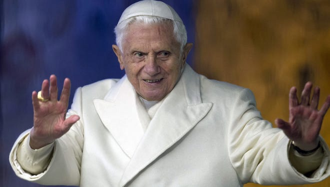 Pope Benedict XVI waves from his popemobile as he visits the Nativity St. Peter's Square at the Vatican, Monday.