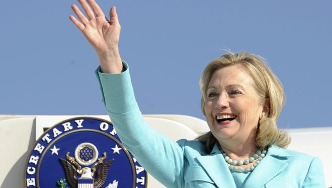 In this June 10, 2011 file photo, Secretary of State Hillary Rodham Clinton waves as the arrives at Lusaka International Airport in Lusaka, Zambia.