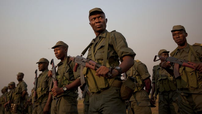 Soldiers from the Republic of Congo, operating under a multinational central-african regional mandate, arrive by airplane to boost existing forces, at an airport in Bangui, Central African Republic Monday.