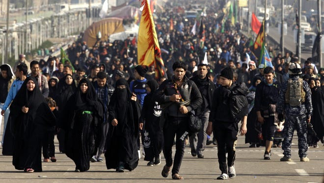 Shiite pilgrims march to Karbala for Arbaeen in Baghdad, Sunday.
