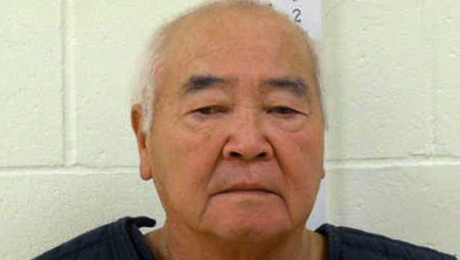In this undated photo provided by York County Jail, James Pak, 74, of Biddeford, Maine, stands during a booking photo.