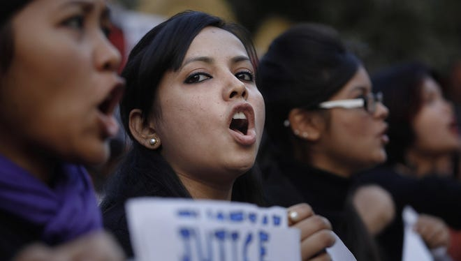 Students shout slogans during a protest against a leader of the ruling Congress party, who was arrested on accusations he raped a woman in a village in the early hours of the morning, in Gauhati, India, Thursday, Jan. 3, 2013.