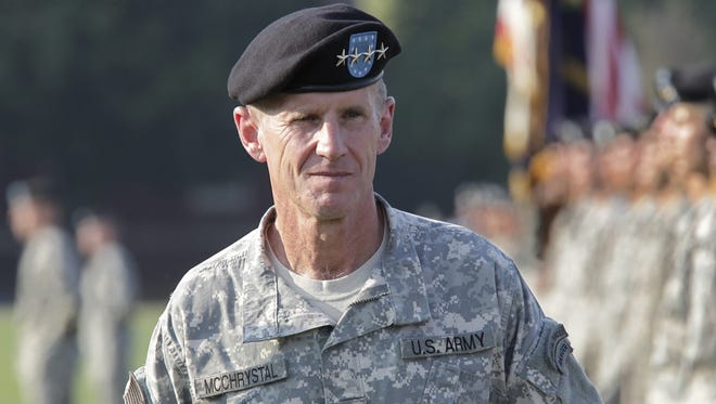 Gen. Stanley McChrystal reviews troops for the last time as he is honored at a retirement ceremony at Fort McNair in Washington on July 23, 2010.