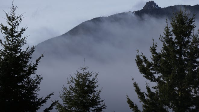 Rugged terrain surrounds the summit of Mount Si, upper right, on Friday,, near North Bend, Wash. Searchers in the air and on the ground were looking for 29-year-old Kurt Ruppert of Lake City, Fla., who has been missing since a skydiving trip on Thursday.