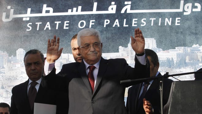 Palestinian President Mahmoud Abbas waves to the crowd during celebrations for their successful bid to win U.N. statehood recognition Dec. 2, 2012.