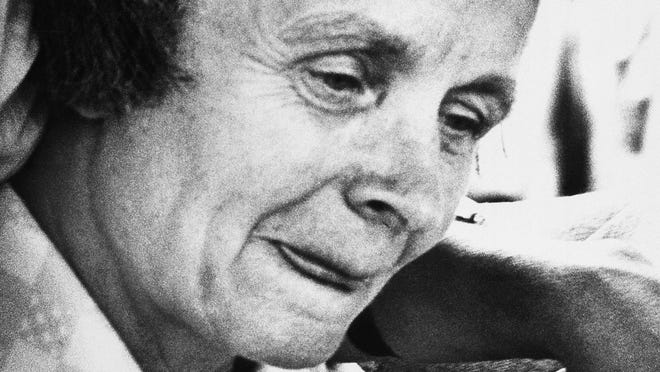 In this July 30, 1979, file photo, Louise Bundy, mother of convicted killer Ted Bundy, leaves court in Miami.