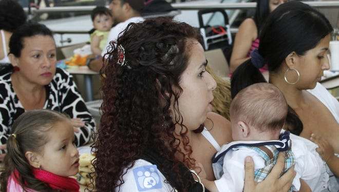 Costa Rican women breast feed their babies during a pro-breastfeeding demonstration at the Plaza Lincoln shopping center in San Jose, Costa Rica, Saturday.