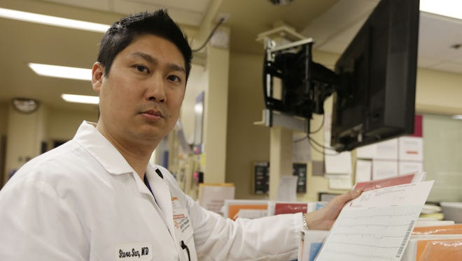 Dr. Steve Sun poses in the emergency room at St. Mary's Medical Center in San Francisco  on Monday. A new government report shows the number of people seeking emergency treatment after consuming energy drinks has doubled nationwide since 2007.