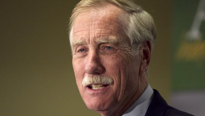Sen. Angus King speaks at a news conference in Freeport, Maine.
