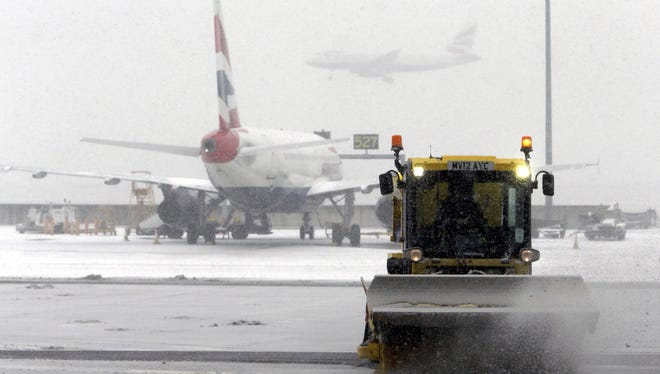 A snow plough clears snow from London's Heathrow Airport last week.