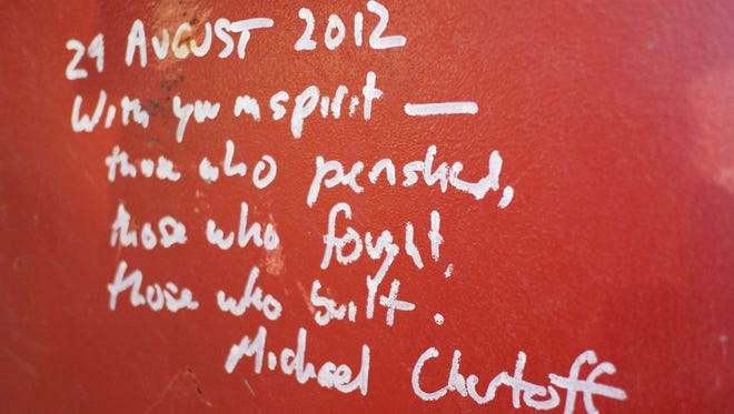 Graffiti left by Michael Chertoff, the former director of Homeland Security, on a steel column on the 104th floor of One World Trade Center in New York.