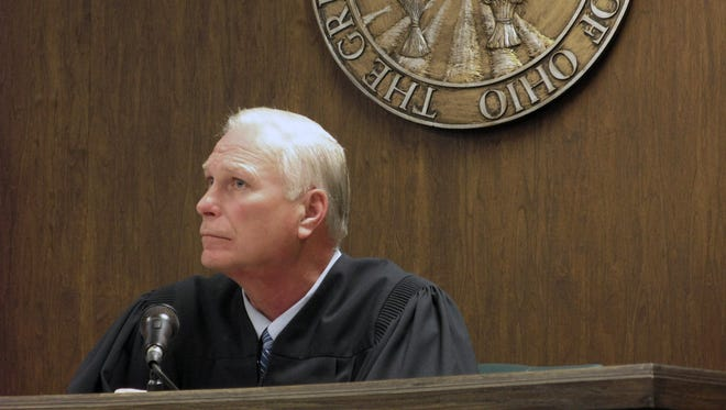 Visiting Judge Thomas Lipps listens to arguments Friday in Jefferson County Juvenile Court in Steubenville, Ohio. (AP Photo/Herald Star, Mark Law)