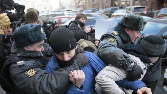 """Police detain supporters of a bill banning """"homosexual propaganda"""" near the State Duma, Russia's lower parliament chamber, in Moscow, Russia, Friday."""