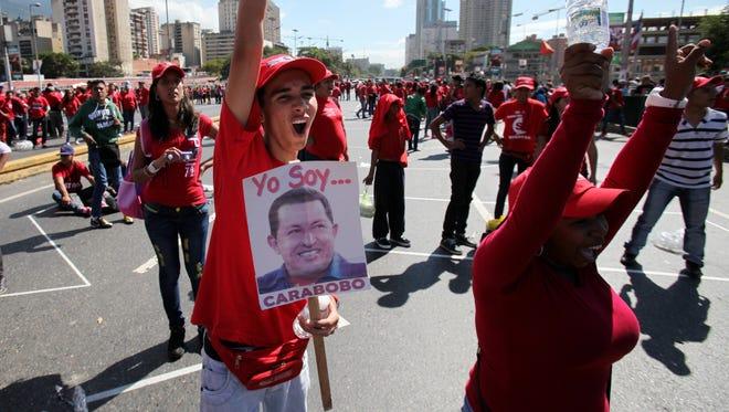 Supporters of Venezuela's President Hugo Chavez shout slogans during a rally in Caracas, Venezuela, Saturday.