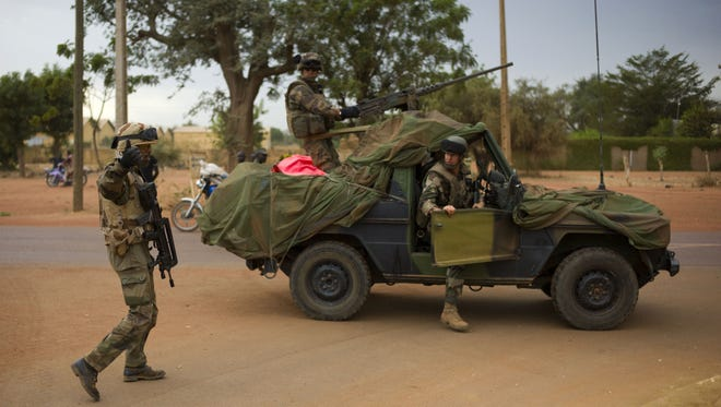 French soldiers stand at a crossroads as they arrive in the city of Sevare, Mali, some 385 miles north of Bamako on Friday.
