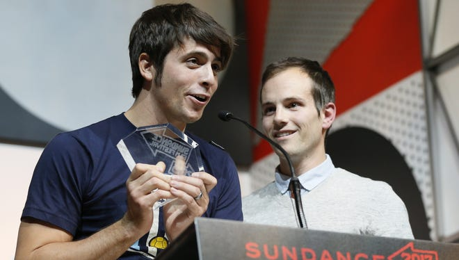 Documentary subject Rocky Braat, left, and director Steve Hoover accept the Grand Jury Prize for 'Blood Brother.'