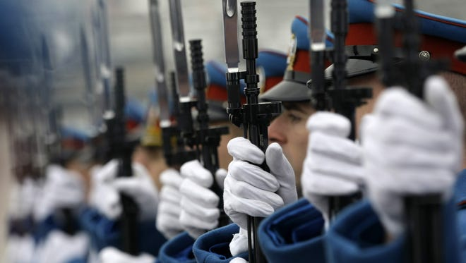 Serbian military honor guards participate in commemorations for victims of the Holocaust at the former World War II Nazi concentration camp of Sajmiste in Belgrade.