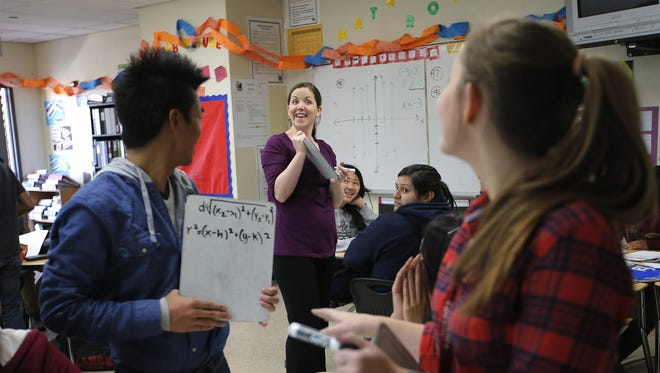 Teacher Crystal Kirch, center, talks to her students in her pre-calculus class at Segerstrom High School in Santa Ana, Calif., Jan. 16.